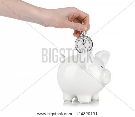 White piggy bank and a hand holding timer above it isolated on white