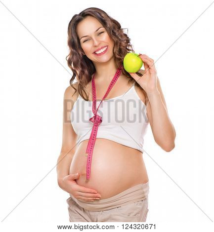 Pregnant Woman measuring her big pregnant belly with measuring tape and eating apple. Healthy food. Mom Expecting Baby. Amazed Pregnant Woman tummy. Pregnancy. Isolated on white background