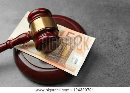 Law gavel with euro on grey background, closeup