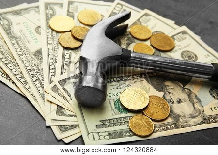 Dollars and hammer, close up