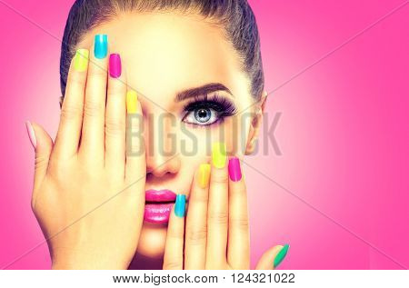 poster of Beauty Girl Face with Colorful Nail polish. Colourful Studio Shot of young Woman. Vivid Colors. Colo