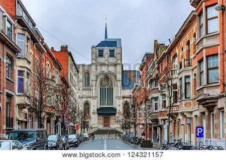Old Brick Houses And Church In Leuven