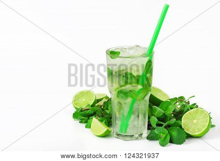 mojito cocktail with lime and mint in tumbler glass with tube on white background with copy space