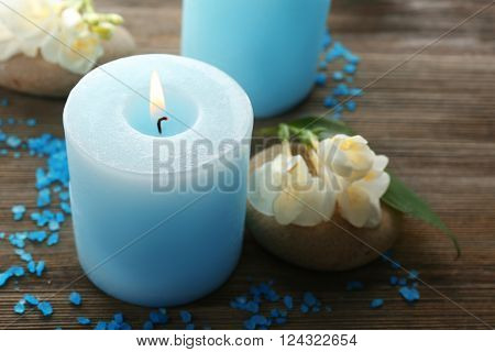 Spa concept. Aroma candle on wooden background, close up
