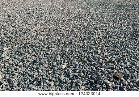 Texture granite gravel. Construction background. Background grey granite gravel