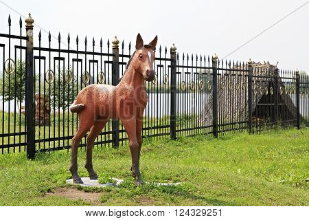 Novotyryshkino, Russia - July 31, 2013: Sculpture foal in Tourist Complex Siberian Podvorye.