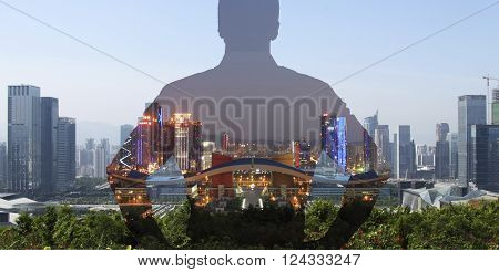 silhouette of a man superimposed on a panorama view of a modern city.