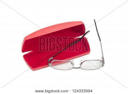 Modern pair of women's eyeglasses with single vision lenses and metal frame and open red spectacle case on a light background