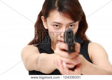 studio shot of a woman with a handgun
