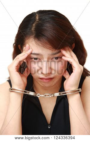 studio shot of arrested woman on white background