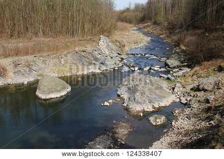 valley of the river with some rocks and stones