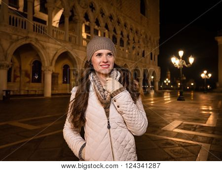 Happy Woman Tourist Standing On St. Mark's Square In Venice