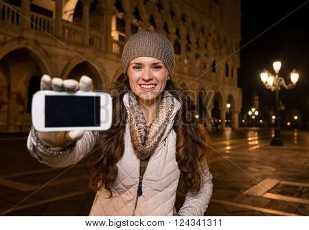 Happy Woman Tourist Showing Smartphone On St. Mark's Square