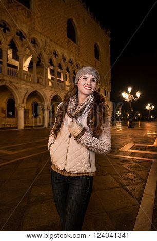 Smiling Woman Tourist Standing On St. Mark's Square In Venice