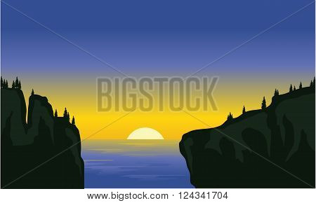 Silhouette of cliff in the sea at morning