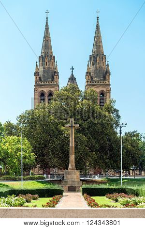 Cross of Sacrifice with St Peter's Cathedral on the background Pennington Gardens South Australia