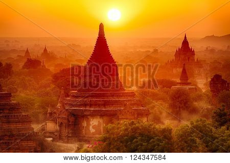 Sun is rising over old pagodas of an ancient city of Bagan, Myanmar
