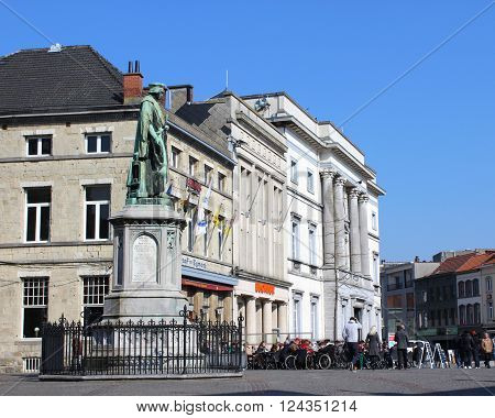 AALST, BEGIUM, MARCH 17 2016: Historic buildings and the statue of Dirk Martens on the main market square in Aalst. Aalst is a large town in East Flanders famous for it's annual carnival parade.