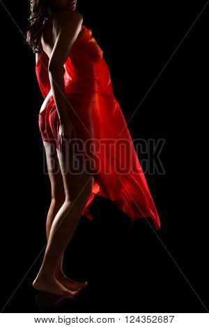 Sexy black woman posing on a balck background