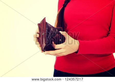 Worried student woman holding empty wallet