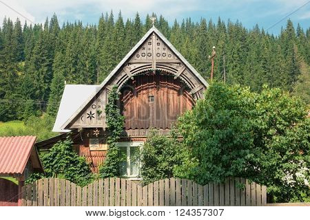 wooden house traditionally decorated in Apuseni Mountain, Romania