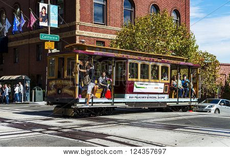 SAN FRANCISCO - OCT 06: Passengers enjoy a ride in a cable car on Oct 06, 2012. It is the oldest mechanical public transport in San Francisco which is in service since 1873.