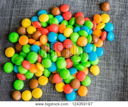 Sweet Bonbons Candy on a jeans background