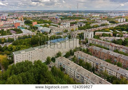 Tyumen, Russia - August 25, 2015: Aerial view on sleeping neighborhood large-panel houses with TV tower, so called KPD. Respubliki and Tulskaya streets intersection