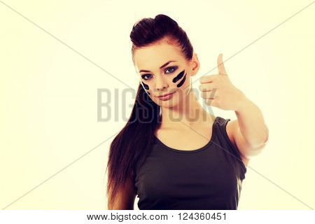 Military woman gesturing ok sign