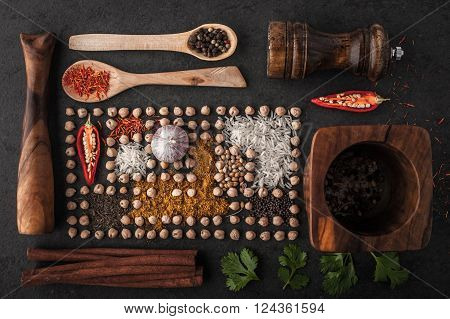 Composition of chick-peas and spice with wooden tableware top view