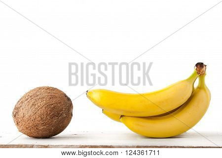 Coconut and bananas on the white background