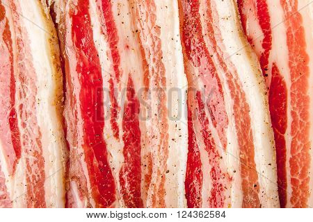 Streaky bacon background close-up white red horizontal