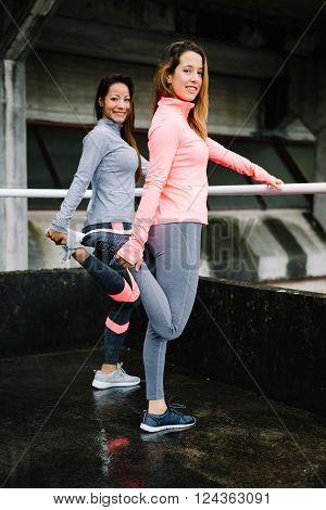 Fitness Women Stretching Legs