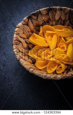 Rose petal in the wicker bowl vertical