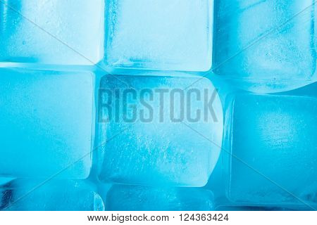 Ice cubes background top view texture, horizontal