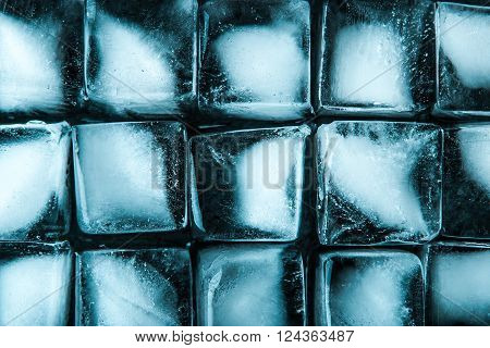 Ice cubes on the dark stone table top view
