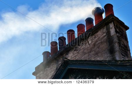Smoking Chimney Stack On House