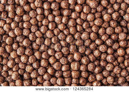 Chocolate crisp ball background horizontal brown close-up