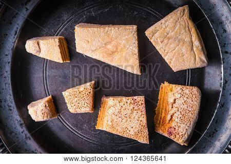 Pieces of pastila on the metal plate top view