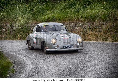 PORSCHE 356 1500 Coupé 1952 PESARO, ITALY - MAY 15: unidentified crew on an old racing car in rally Mille Miglia 2015 the famous italian historical race (1927-1957) on May 2015