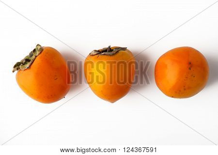 Persimmons orange on the white background horizontal