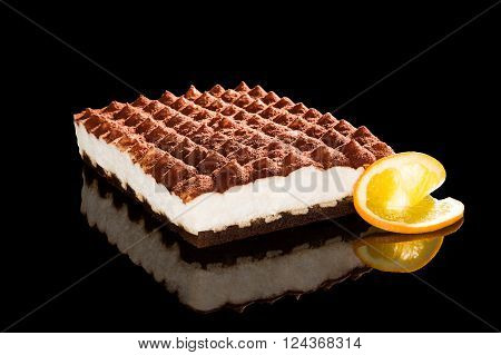 Delicious tiramisu dessert isolated on black background. Traditional sweet dessert.