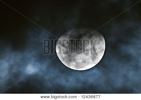Waning Gibbous Moon Behind The Clouds