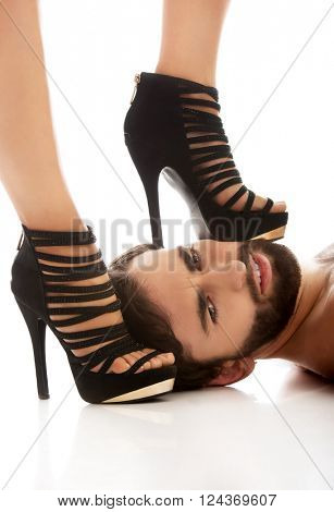 Woman's foot on man's face.