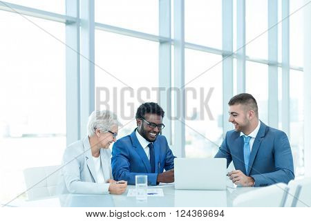 Business people with laptop indoors