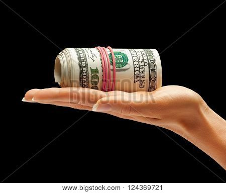 Womens Hand holding Money isolated on black background. Business concept