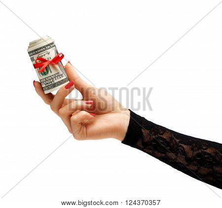 Womens Hand holding Money with red ribbon isolated on white background. Business concept