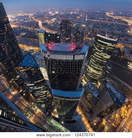 MOSCOW, RUSSIA - MAR 22, 2016: Skyscrapers of Moscow City business complex at night. Moscow International Business Center Moscow City includes 20 futuristic buildings