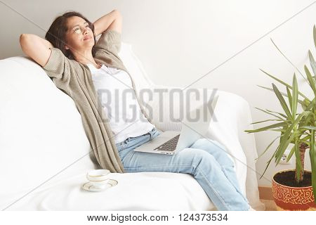 Portrait Of Attractive Middle-aged Brunette Businesswoman In Eyeglasses At Home Working On Laptop Co