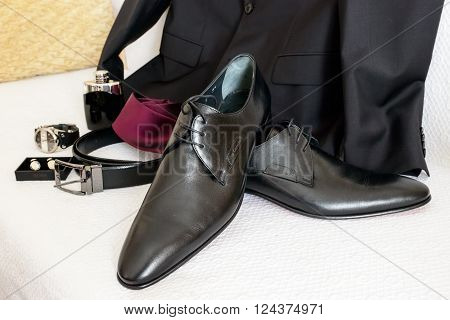 ATHENS GREECE - OCTOBER 25 2015: Arrangement of men's stylish and elegant accessories next to a suit